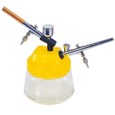 Airbrush overspray container prevents messes on your workstation.